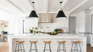 Farmhouse kitchen with black pendants