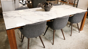 Marble table top with wood legs and wool chairs