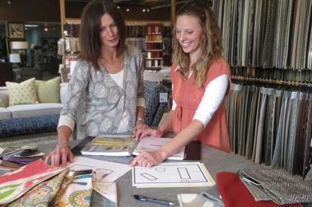 Designers assisting clients at by Design - Des Moines