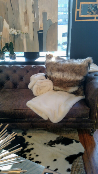 Leather sofa and throw